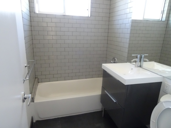 After Renovation Bathroom with subway tiles and new vanity
