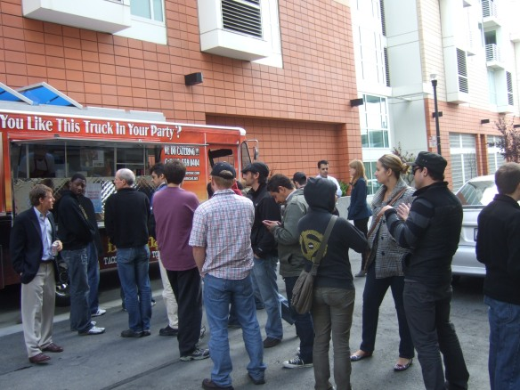 Despite gourmet lunches catered by Tech Companies located in PMI SOMA San Francisco Office Buildings, Tech workers line up to get a free taco from a popular food truck vendor.