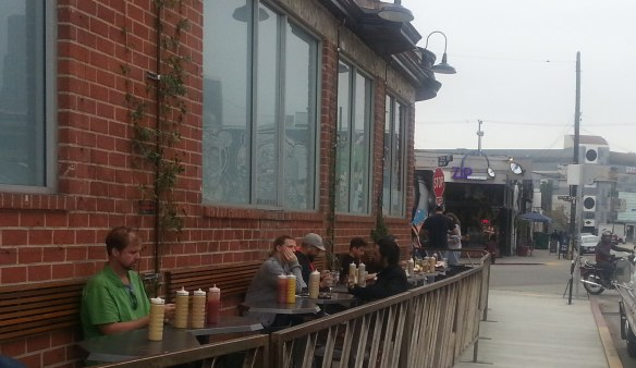 Art District Patron Sitting outdoors in restaurant.